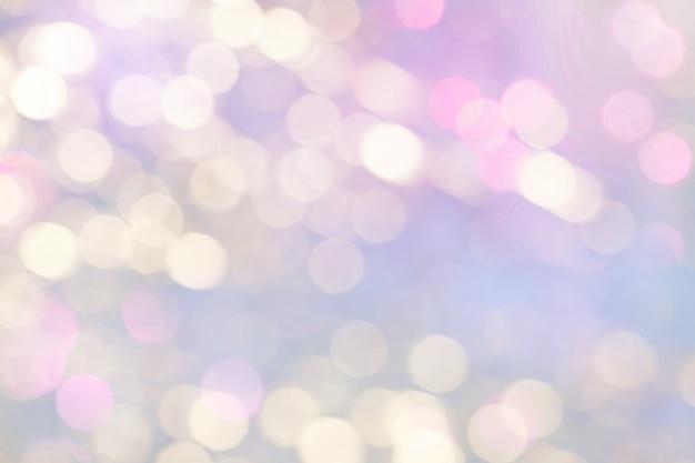 Bright light pink blurred holiday bokeh lightsbackground