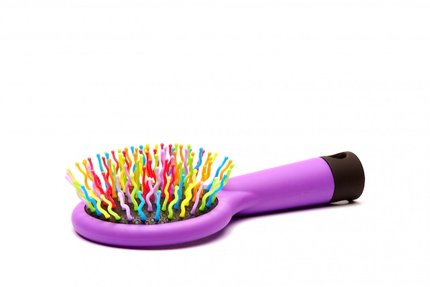 Bright multi-colored hair comb on a white background.