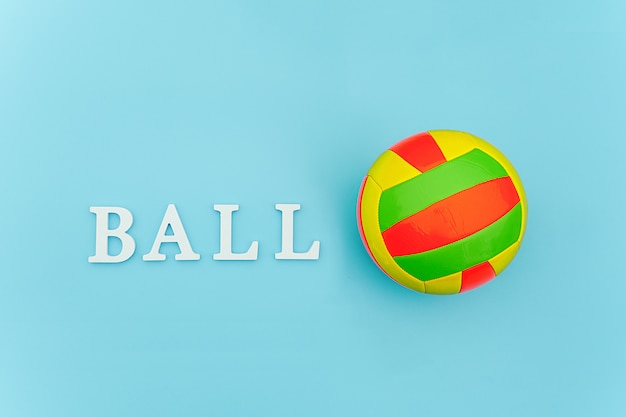 Bright multi-colored volleyball ball and text