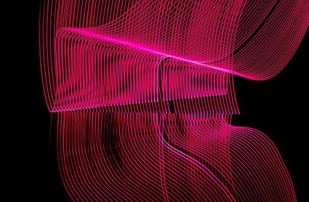 明るいネオンラインデザインの背景、長時間露光で撮影、ピンク