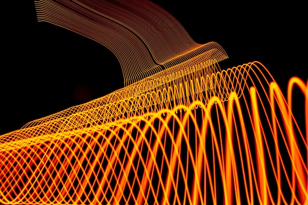 Bright neon line designed background, shot with long exposure, yellow gold