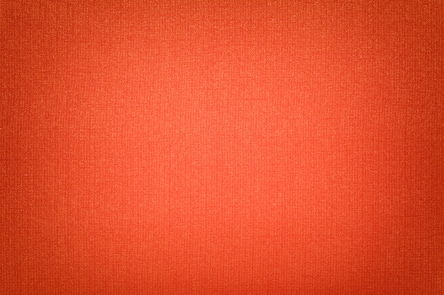 Bright orange background from a textile material with wicker ,