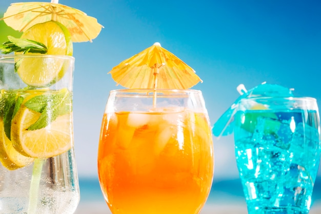 Bright orange blue fresh drinks in glasses