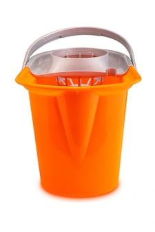 Bright orange mop bucket on white