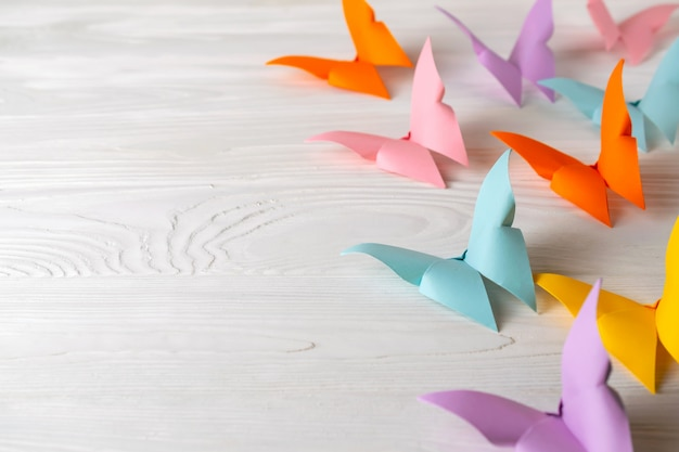 Bright origami paper butterflies with copy space for your text