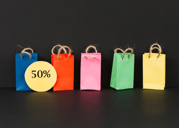 Bright packets with sale label