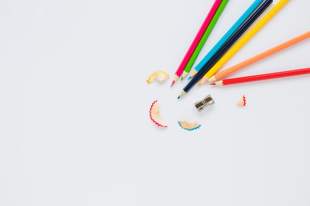 Bright pencils near sharpener and shaving