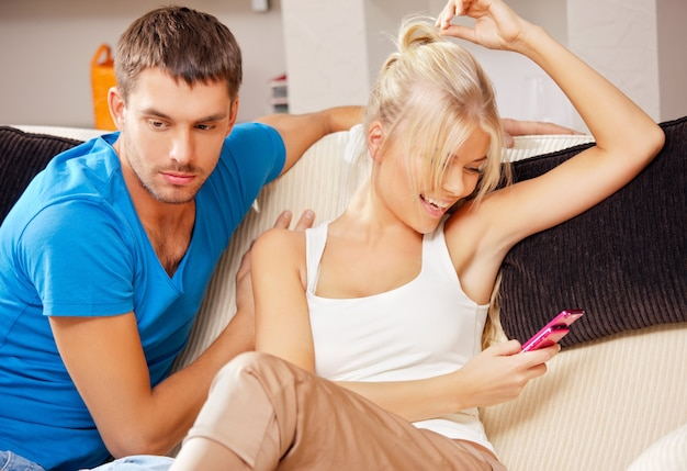 Bright picture of couple at home with cellphone