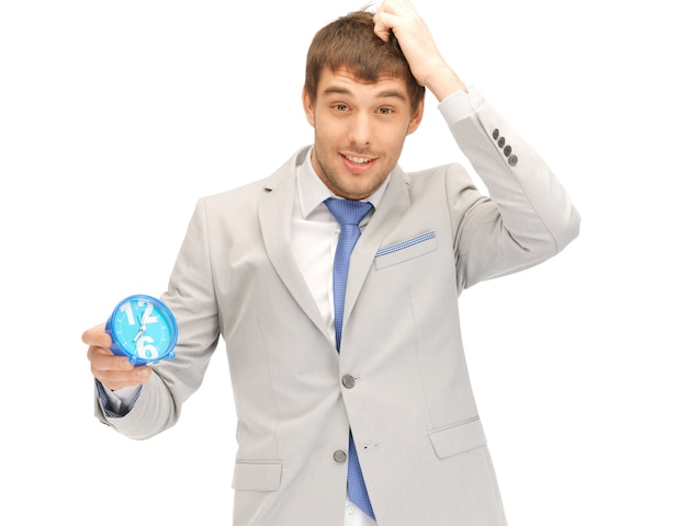 Bright picture of handsome man with clock