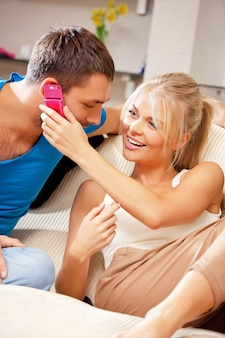 Bright picture of happy couple with cellphone