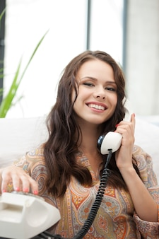 Bright picture of happy woman with phone