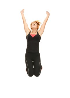 Bright picture of jumping fitness instructor over white