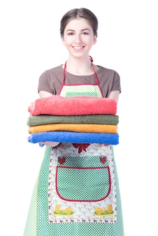 Bright picture of lovely housewife with towels.