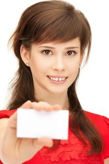 名刺で自信を持って10代の少女の明るい写真