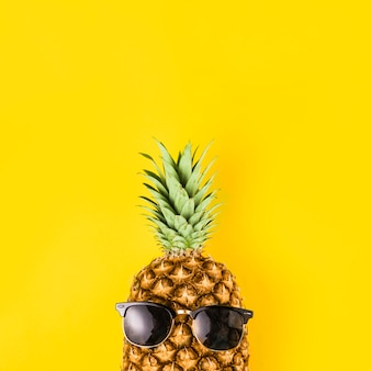Bright pineapple in sunglasses