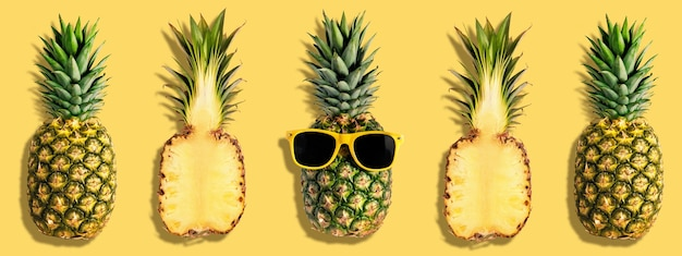 Bright pineapples pattern on yellow background