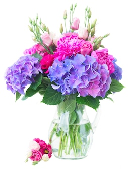 Bright pink peony, eustoma and blue hortensia flowers bouquet isolated on white