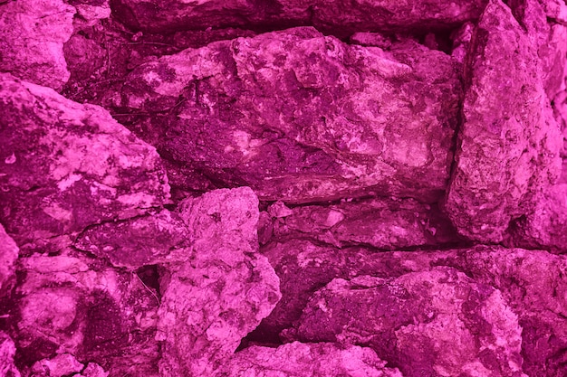 Bright pink stone texture and background, natural sandstone surface