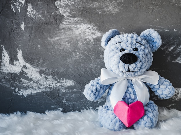 Bright plush toy with a red heart