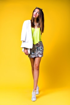 Bright positive fashion portrait of pretty young woman, stylish trendy neon outfit, smart casual, cute emotions, color pop