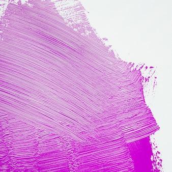 Bright purple brushstroke on wall