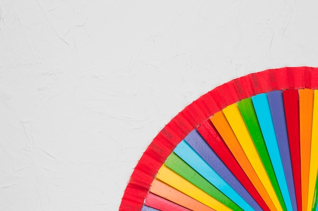 Bright rainbow fan on white surface