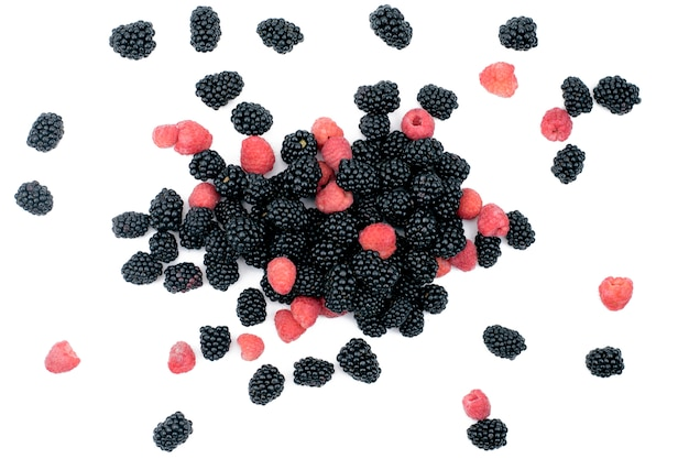 Bright red and black berries raspberries and blackberries on white isolated.