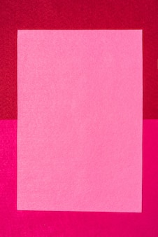 Bright red felt background with satin ribbon.