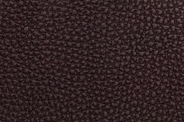Bright red leather texture background closeup photo