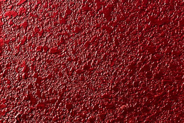 設計作業のための真っ赤に塗られたコンクリートの壁