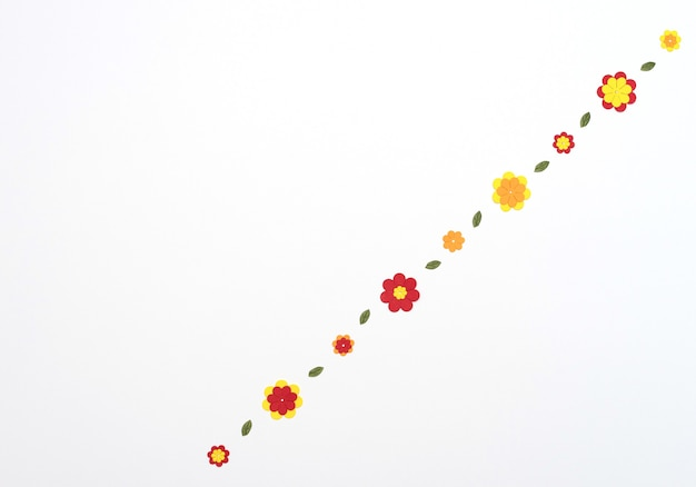 Bright red, yellow, orange paper flowers on white background. spring, summer concept. flat lay style with copy space. paper art