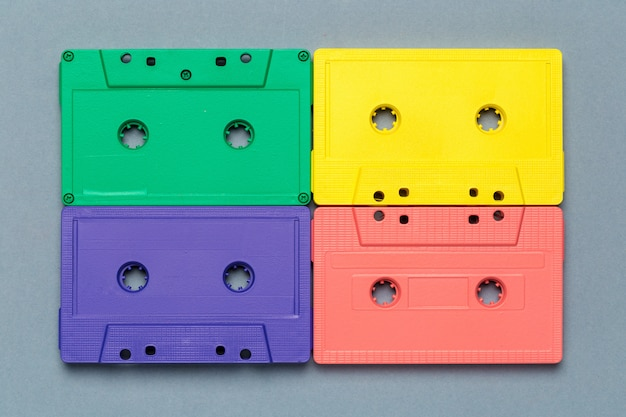Bright retro cassette tapes on a light grey