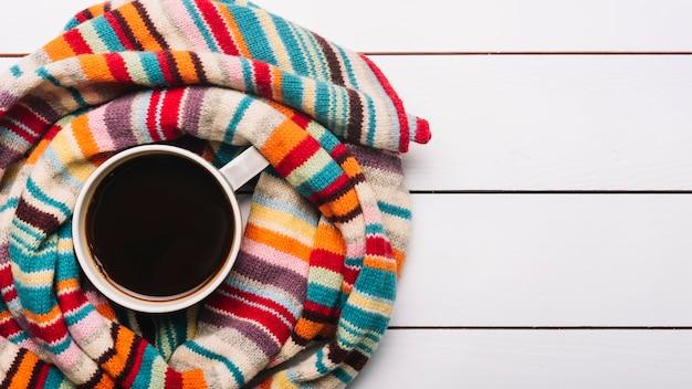 Bright scarf around coffee