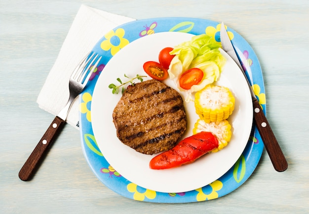 Bright serving of grilled steak and vegetables