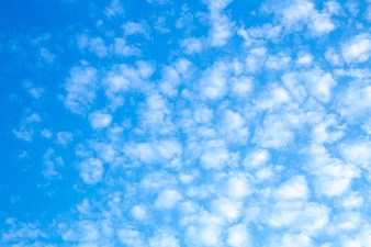 Bright sky with beautiful floating clouds for background image.