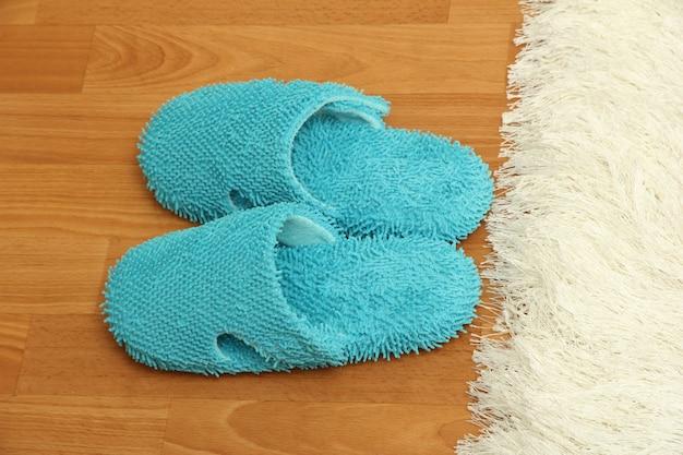 Bright slippers, on floor