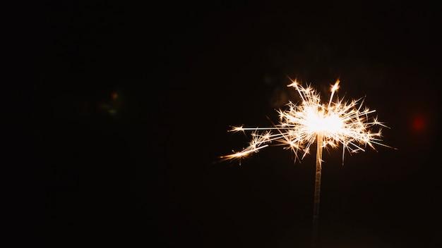 Bright sparkler on dark