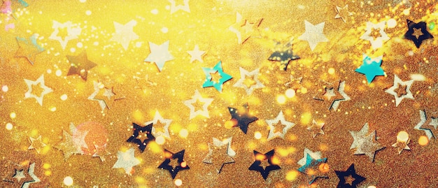 Bright stars on gold background with bokeh