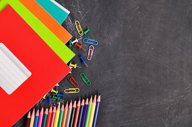 Bright stationery on a blackboard