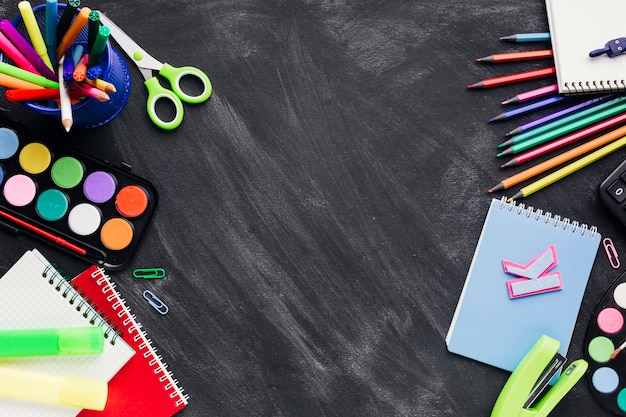 Bright stationery on left and right on dark background
