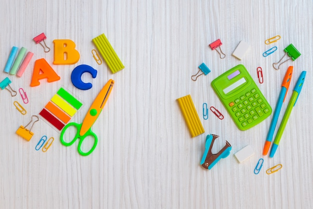 Bright stationery on white board, back to school