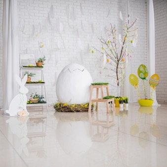 Bright studio prepared for easter and decorated with eggs and greenery