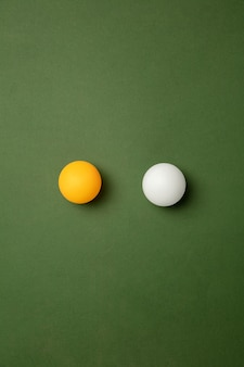 Bright table tennis, ping pong balls. professional sport equipment isolated on green background.