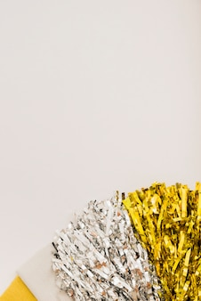 Bright tinsel on light table