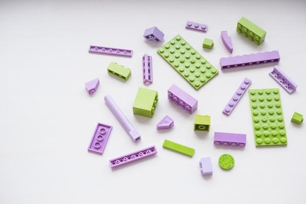 Bright toy bricks on white table