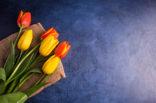 Bright tulips bouquet on table