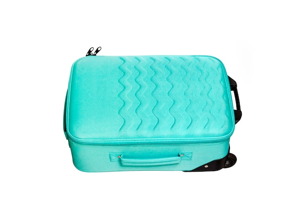 Bright turquoise travel suitcase isolated on white surface