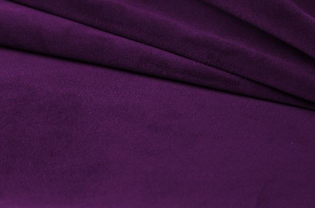Bright ultraviolet velour textile sample. fabric texture background