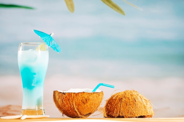 Bright umbrella decorated cocktail and coconut milk with straw