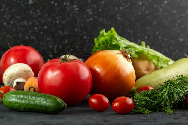 Bright vegetables ripe fresh mellow colorful vegetables on grey background